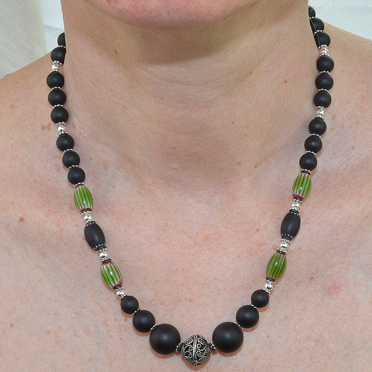 Filigree silver bead with matt onyx and green melon chevron bead necklace