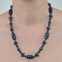 Blue skunk bead necklace with antique lamp beads