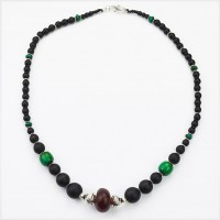 Antique amber centre bead necklace with matt onyx and turquise gemstone beads