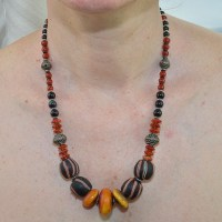 Striking amber and carnelian necklace with onyx gemstone beads