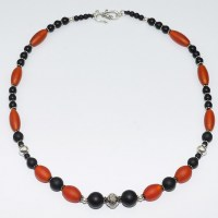 Orange oval glass bead and onyx necklace